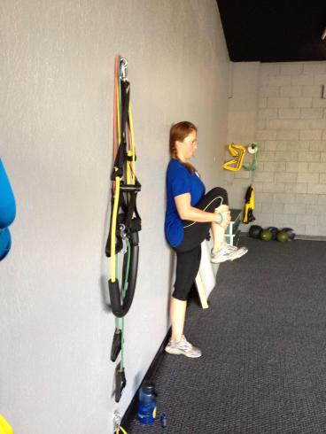 Kim Mann post injury working on assisted knee hugs